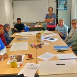 "Moody's Volunteers ""TeamUp"" to Support ESOL Workshops"